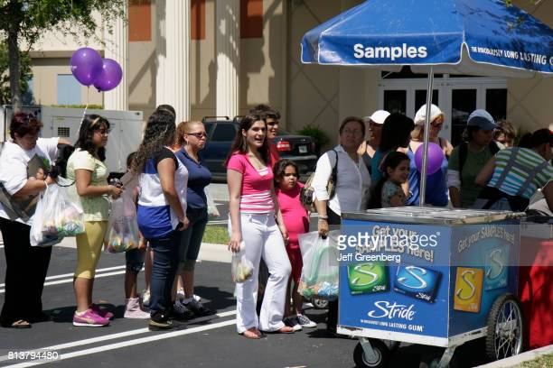 A line for free samples of Stride gum at the street fair at Calle Ocho