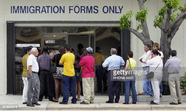 A line forms near the entrance of the Immigration and Naturalization Service office in Miami 30 April 2001 as the midnight deadline approaches for...