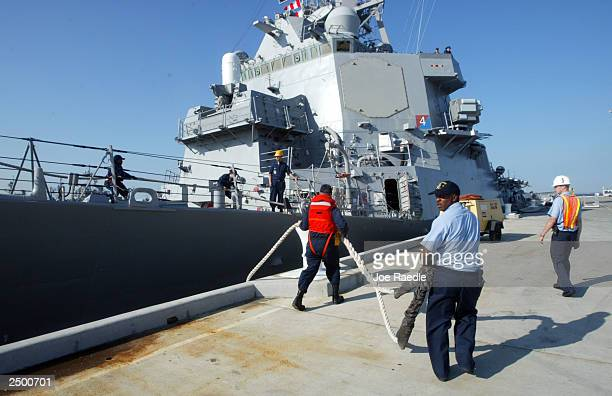 Line handlers cast off the destroyer USS Porter as it gets underway to avoid potential damage as hurricane Isabel continues its march toward landfall...