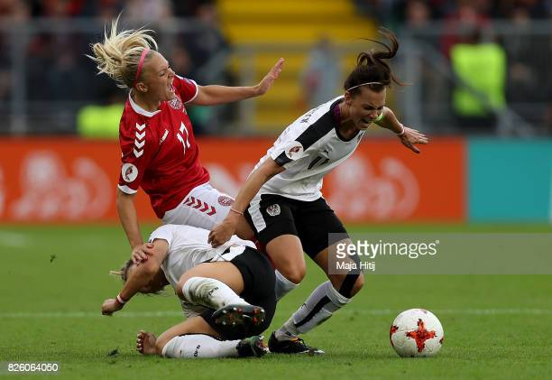 Line Jensen of Denmark is tackled by Viktoria Schnaderbeck of Austria during the UEFA Women's Euro 2017 Semi Final match between Denmark and Austria...