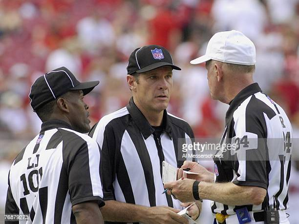 NFL line judge Carl Johnson field judge Scott Edwards and referee Gerald Austin discuss a ruling as the Tampa Bay Buccaneers host the New Orleans...