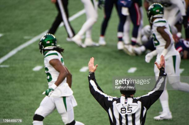 Line Judge Daniel Gallagher signals for a touchdown in the second half of the game between the New York Jets and New England Patriots at Gillette...