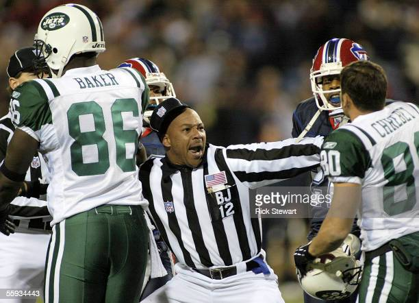 Line Judge Greg Steed tries to separate Wayne Chrebet of the New York Jets from Buffalo Bills players during an altercation in the fourth quarter on...