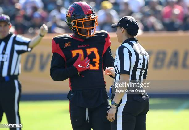 Line judge Maia Chaka stands on the field as she talks with running back Dujuan Harris of the Los Angeles Wildcats as she waits for play to resume at...