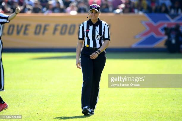 Line judge Maia Chaka stands on the field as she waits for play to resume during the game between the Los Angeles Wildcats and the Dallas Renegades...