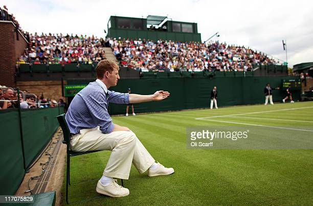 A line judge makes a decision on court 18 on Day One of the Wimbledon Lawn Tennis Championships at the All England Lawn Tennis and Croquet Club on...