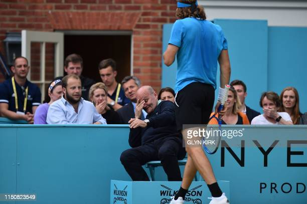 Line judge reacts afer being hit during between the men's singles round of 32 match between Greece's Stefanos Tsitsipas returns and Britain's Kyle...