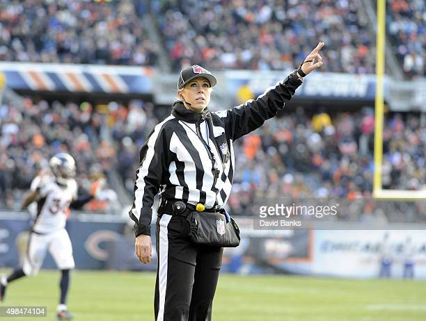 Line judge Sarah Thomas makes a signal during a game between the Chicago Bears and the Denver Broncos on November 22 2015 at Soldier Field in Chicago...