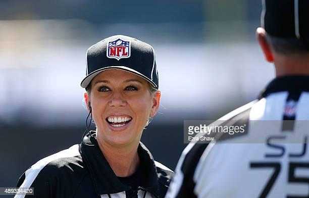 Line Judge Sarah Thomas watches pregame activites between the Baltimore Ravens and Oakland Raiders at OaklandAlameda County Coliseum on September 20...