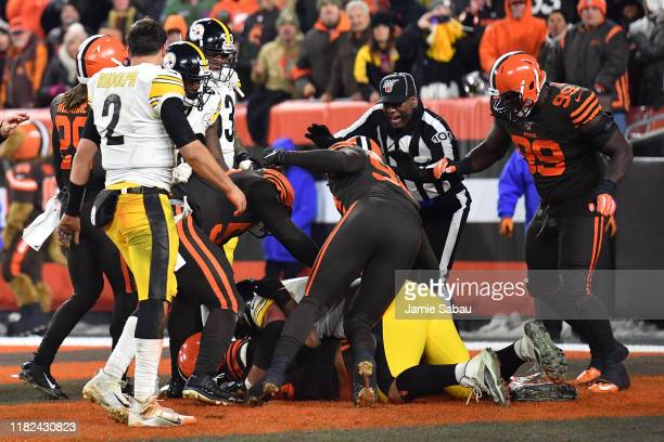 Line Judge Tom Symonette attempts to break up a fight in the end zone between the Pittsburgh Steelers and the Cleveland Browns near the end of the...