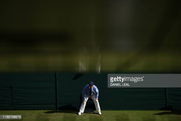 A line judge watches his line as Spain's Rafael Nadal plays against Australia's Nick Kyrgios during their men's singles second round match on the...