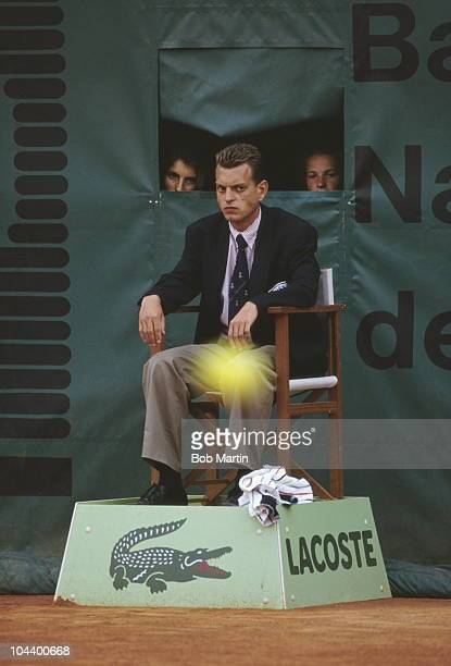 Line judge watches the ball together with two onlookers behind him during a match at the French Open Tennis championships on 1st June1986 at the...