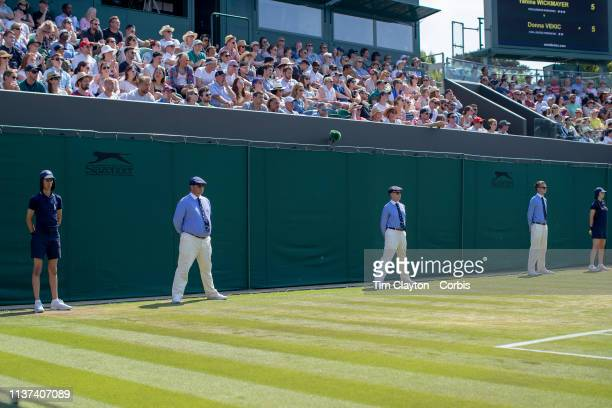 July 6: Line judges and ball boys and girls ready for action during the Ladies Singles Competition at the Wimbledon Lawn Tennis Championships at the...