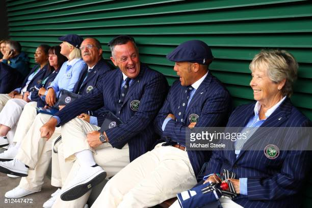 Line judges shelter as rain stops play on day eight of the Wimbledon Lawn Tennis Championships at the All England Lawn Tennis and Croquet Club on...