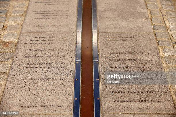 A line marks the 'Prime Meridian of the World' at Longitude 0º at the Royal Observatory in Greenwich on March 26 2012 in London England The Royal...