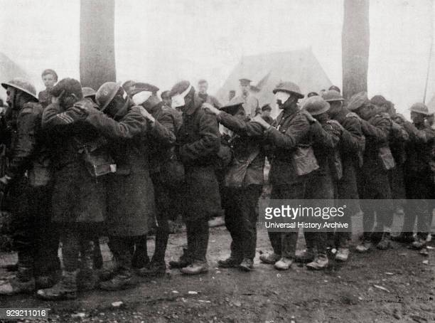 A line of 55th Infantry Division troops blinded by gas waiting for treatment outside an advanced dressing station near Bethune after the Battle of...