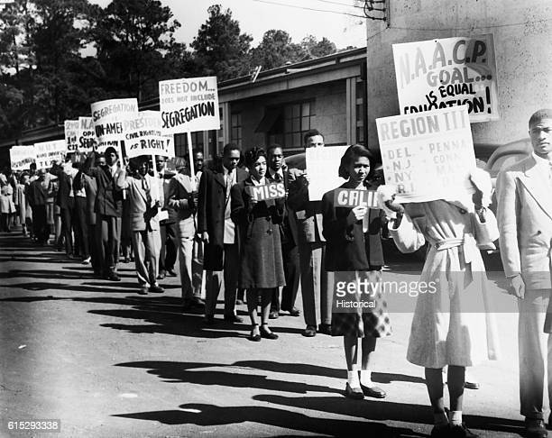 A line of African Americans hailing from states across the USA march to protest segregation Ca 1950