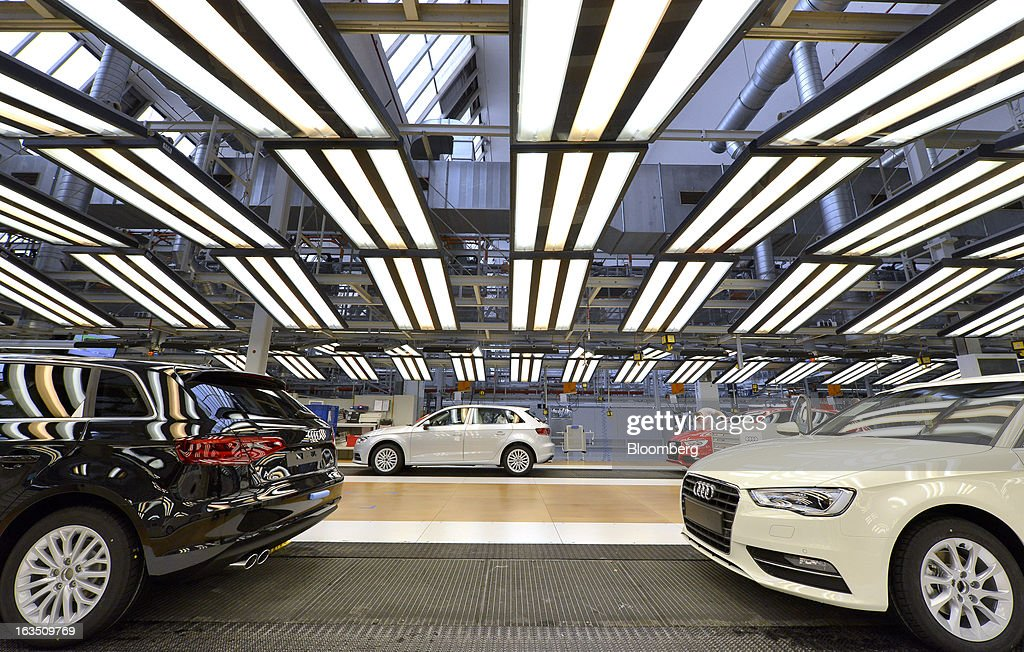 A line of Audi A3 automobiles, produced by Volkswagen AG's Audi brand, await the final inspection at the company's plant in Ingolstadt, Germany, on Monday, March 11, 2013. Audi, the world's second-largest maker of luxury vehicles, plans to spend 13 billion euros ($17 billion) through 2016 to develop new cars and expand production capacity as it pursues Bayerische Motoren Werke AG's sales lead. Photographer: Guenter Schiffmann/Bloomberg via Getty Images