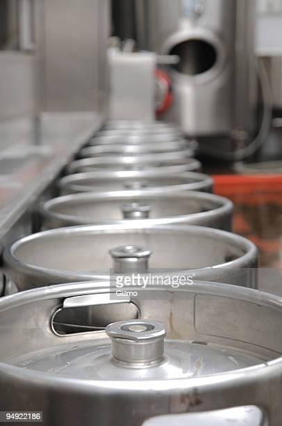Line of beer metal barrels on a brewery