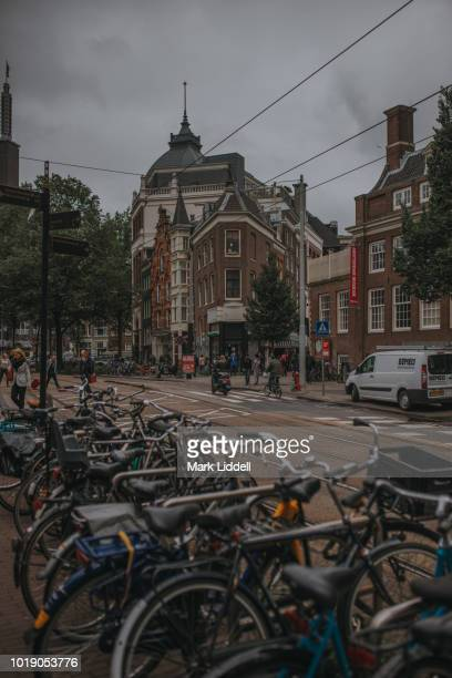 line of bicycles on the streets of amsterdam - mark's stock pictures, royalty-free photos & images