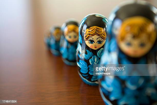 Line of blue matryoshka dolls with focus on the second doll