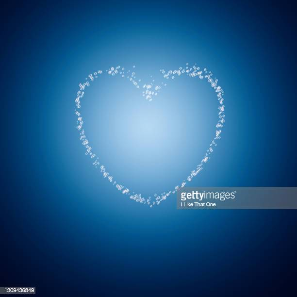 line of bubbles forming a heart - atomic imagery stock pictures, royalty-free photos & images
