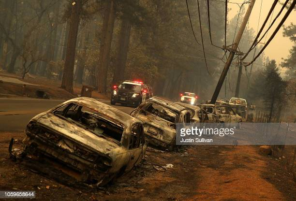 A line of burned out abandoned cars sit on the road after the Camp Fire moved through the area on November 9 2018 in Paradise California Fueled by...