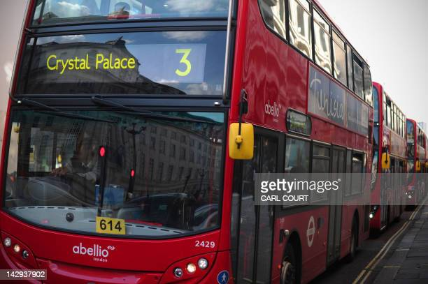 A line of buses queue at a red traffic light in central London on April 11 2012 Despite seven years of planning and a colossal budget transport...
