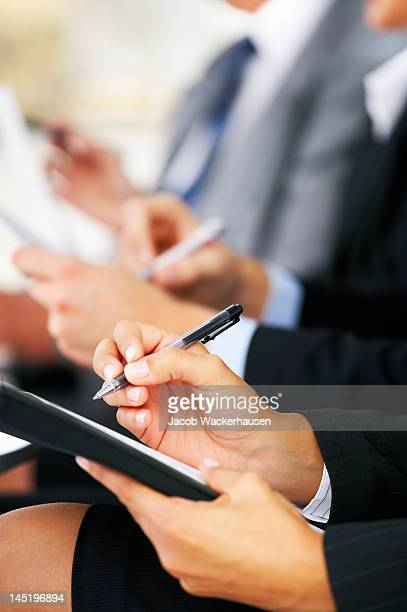 Line of business people taking notes
