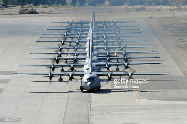 A line of C-130 Hercules taxi at Nellis Air Force Base, Nevada.