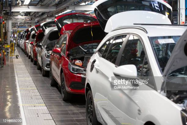 A line of cars on a car assembly line at the Vauxhall car factory during preparedness tests and redesign ahead of reopening following the COVID19...