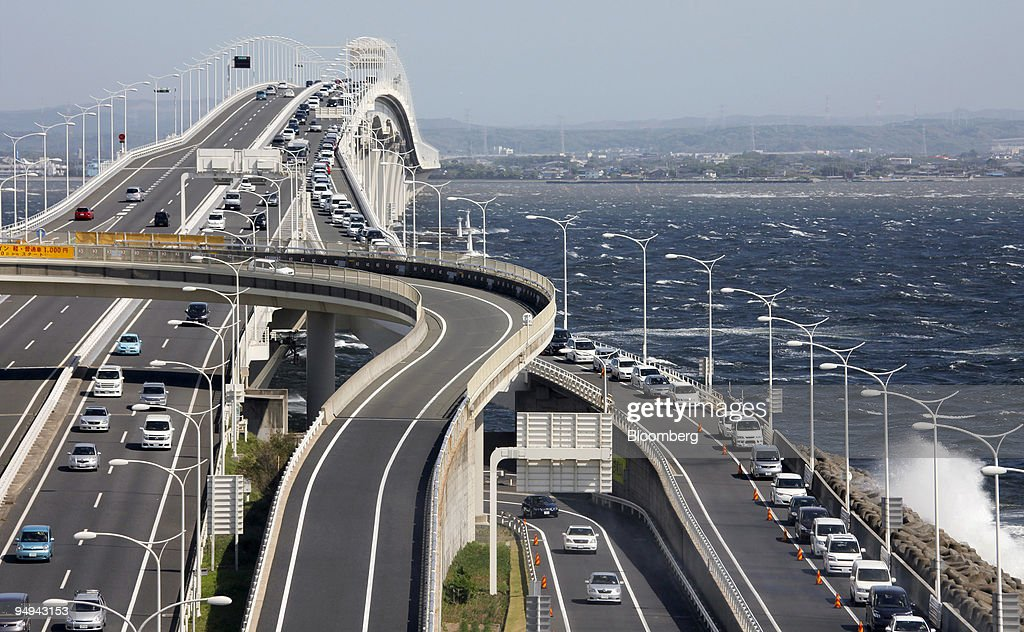 A line of cars on the Tokyo Bay Aqua-Line highway, right, wa ...