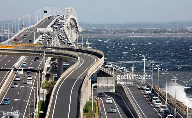 A line of cars on the Tokyo Bay AquaLine highway right wait to enter the parking lot of the Umihotaru rest area in Kisarazu Chiba prefecture Japan on...