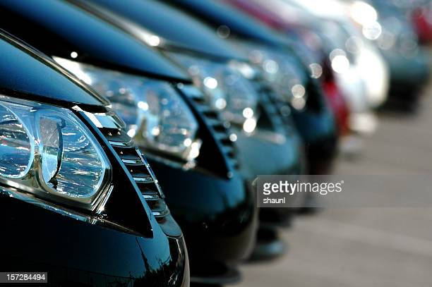 line of cars - in a row stock pictures, royalty-free photos & images