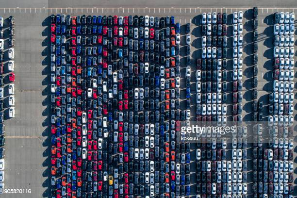 a line of cars. - car transporter stock photos and pictures