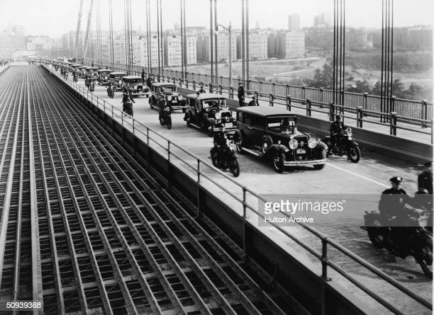 A line of cars travel over the George Washington Bridge for the first time bearing city officials and speakers en route to the opening day ceremonies...