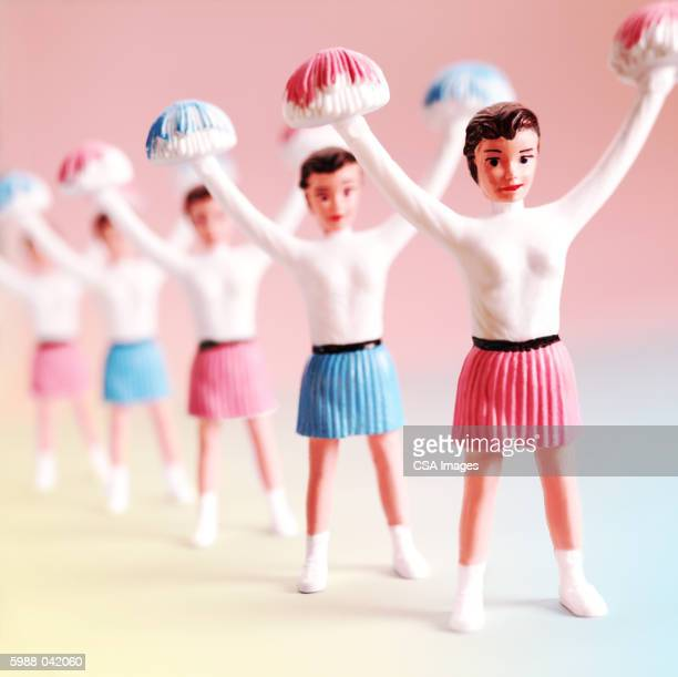 line of cheerleader figurines - cheerleader up skirt stock photos and pictures