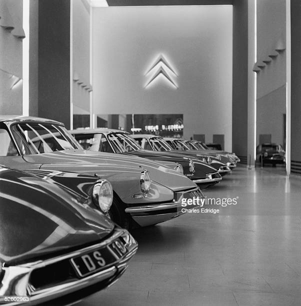 A line of Citroen DS cars in the main Citroen showroom on the Champs Elysees in Paris mid 1960s