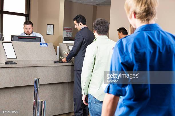 line of customers at the bank - cashier stock pictures, royalty-free photos & images