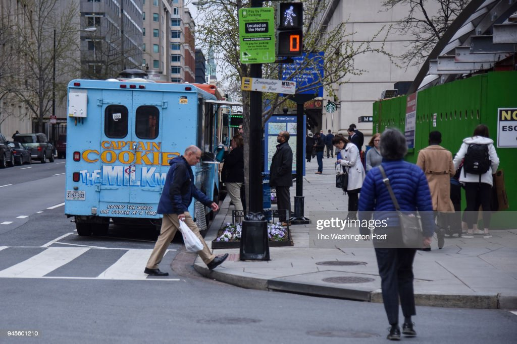 A line of customers forms at Captain Cookie food truck on Wednesday, April 11, 2018, in Washington, DC. Kirk Francis, the Founder of Captain Cookie, discusses how revised rules for food trucks are putting a pinch on the business.