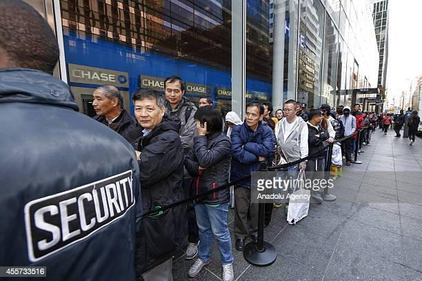A line of customers on 59th street as they wait to enter the Fifth Avenue Apple store to purchase the new iPhone 6 in New York United States on 19...