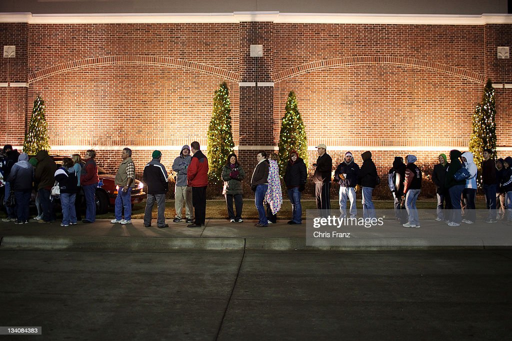 A Line Of Customers Wait For Scheels All Sports To Open At 7 Am On