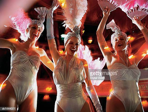 line of dancers performing on stage - cabaret stock pictures, royalty-free photos & images