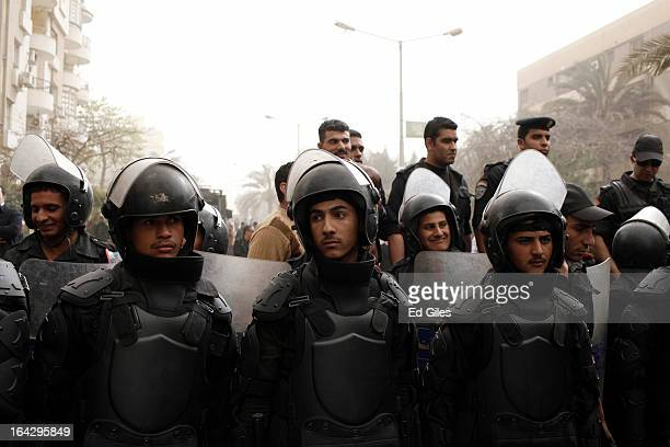Line of Egyptian riot police stand in formation during a demonstration at the headquarters of the Muslim Brotherhood on March 22, 2013 in Cairo,...