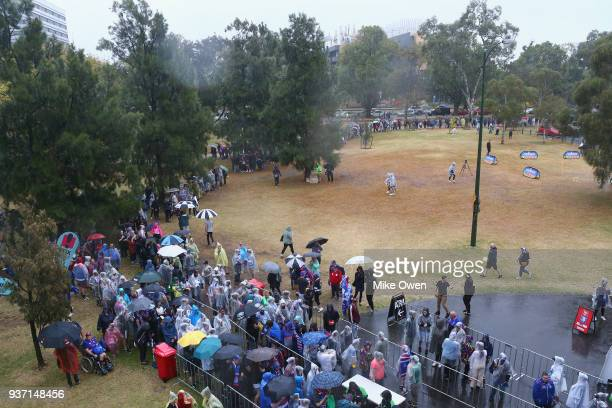 A line of fans wait to get in before the AFLW Grand Final match between the Western Bulldogs and the Brisbane Lions at Ikon Park on March 24 2018 in...