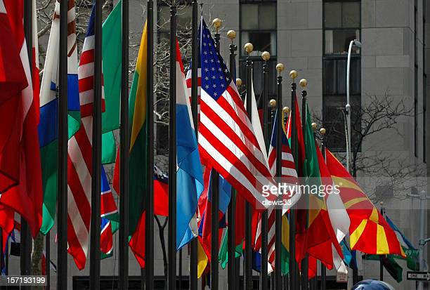 line of flags from all different countries and nations - international politics stock pictures, royalty-free photos & images