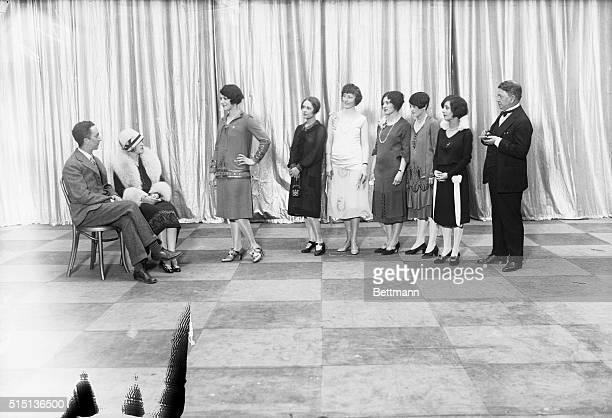 Line of girls, entered in the contest being held by the Broadway Association to select as 'Miss Broadway' as they appeared watching Judges Norman...