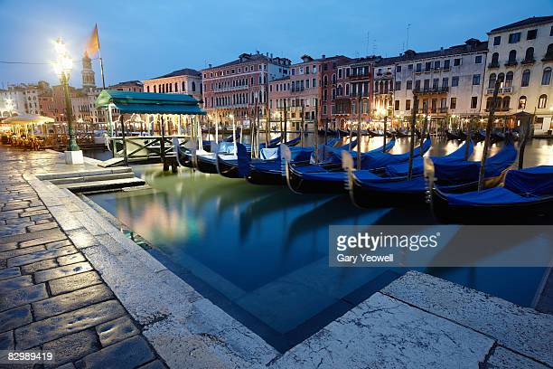 line of gondolas along grand canal at dusk.  - yeowell stock photos and pictures