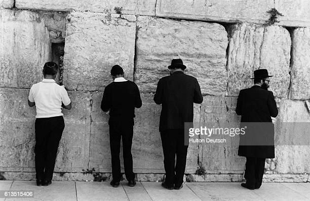 Line of Hasidic Jews prays at the wailing wall on the twenty-fifth anniversary of Israel's independence.