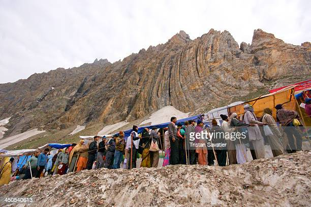 Line of Hindu pilgrims waiting to enter the cave. Every summer, hundreds of thousands of Hindu devotees do the pilgrimage to the holy Amarnath cave,...